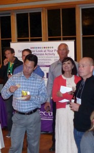 Conference-attendees-being-welcomed-to-reception